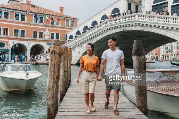 young adult asian couple exploring venice, italy - venice stock pictures, royalty-free photos & images
