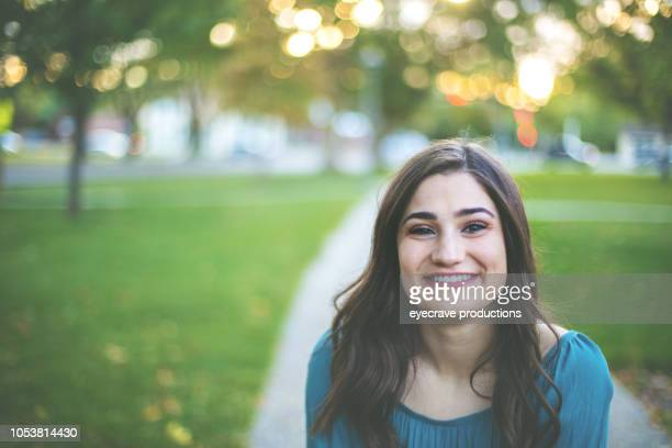 Young Adult Attractive Female College Student Early Autumn Fun in a Public Park