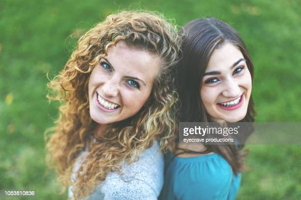 Young Adult Attractive Female College Students Early Autumn Fun in a Public Park