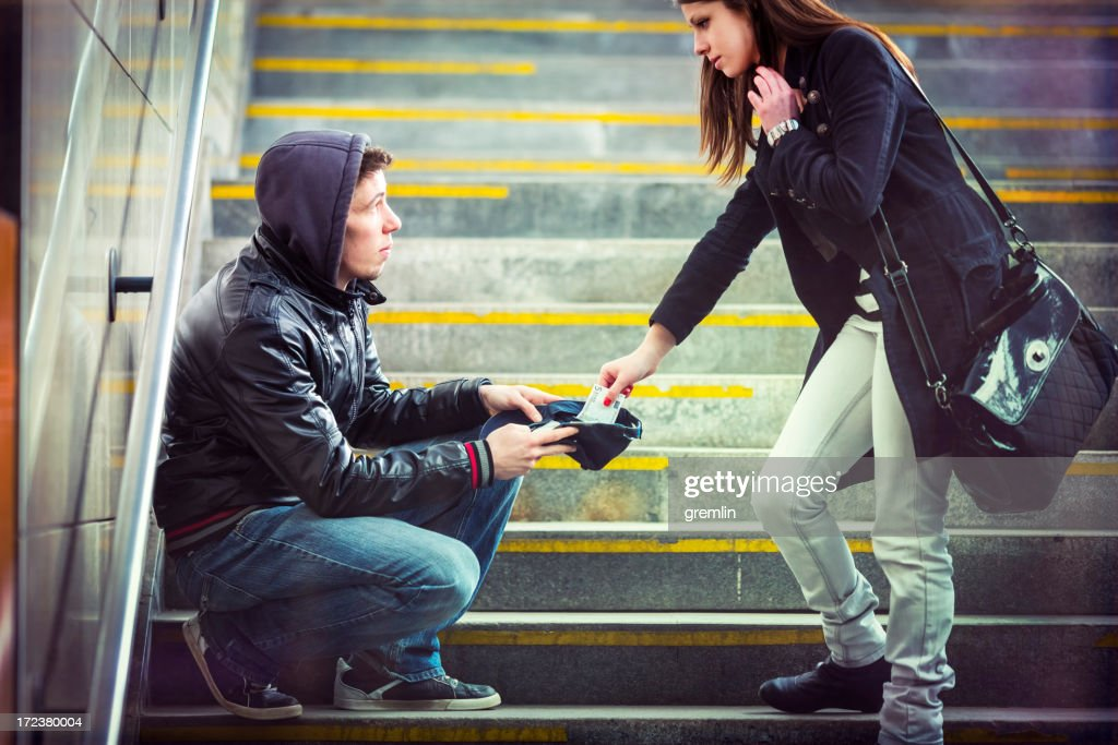 Young adult begging on the streets of Europe : Stock Photo