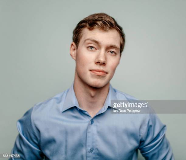 Young adult businessman in blue shirt