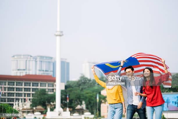 young adult celebrating malaysia independence day - national holiday stock pictures, royalty-free photos & images