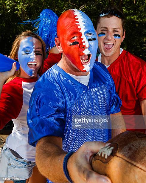 young adult college football fans tailgating - intense excitement - face paint stock pictures, royalty-free photos & images