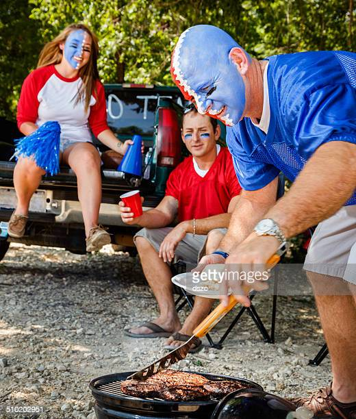 Young Adult College Football Fans Tailgating with barbeque grilled food