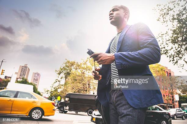 Young adult commuter going at work in the city streets
