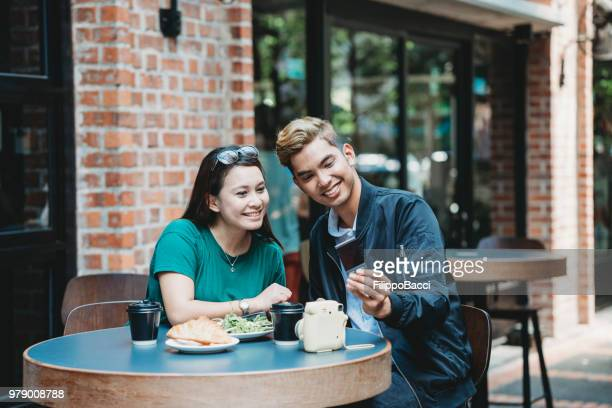Young adult couple at the bar together