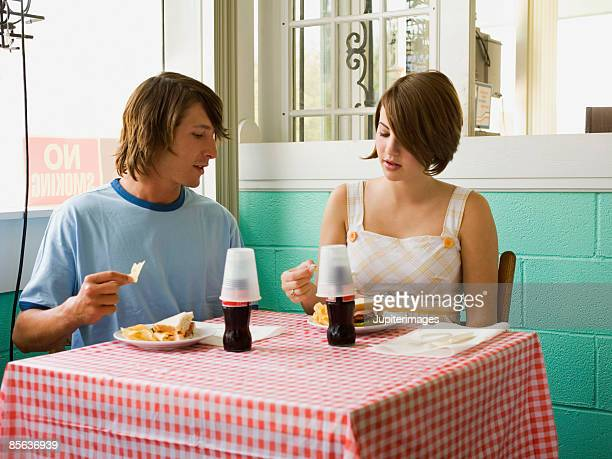 Young adult couple in cafe