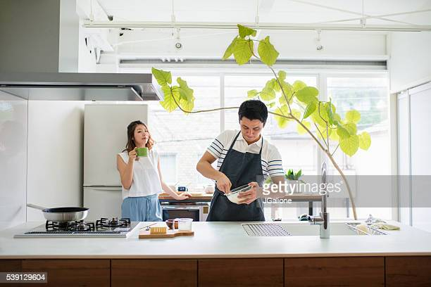 Young adult couple in the kitchen together