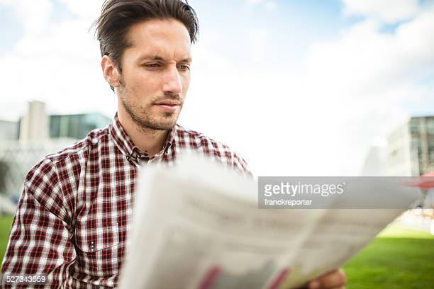 young adult entrepreneur reading the newspaper
