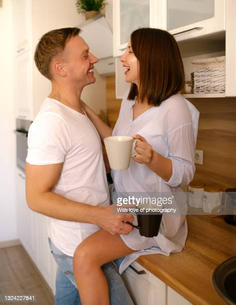 young adult european heterosexual couple at new home just married, 30-35 years - 25 29 years stock pictures, royalty-free photos & images