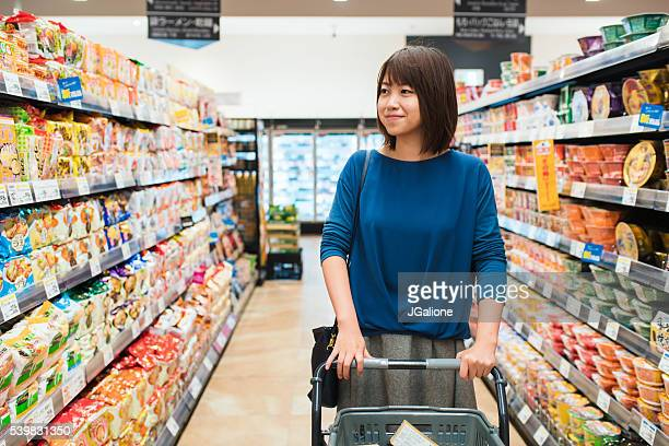 Young adult female grocery shopping