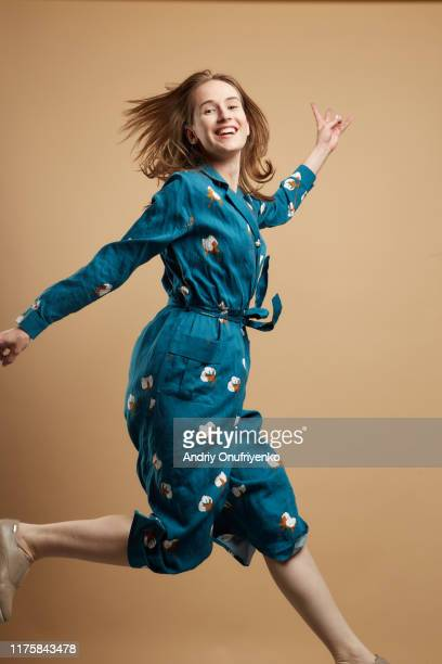 young adult female jumping for joy - 宙に浮かぶ ストックフォトと画像