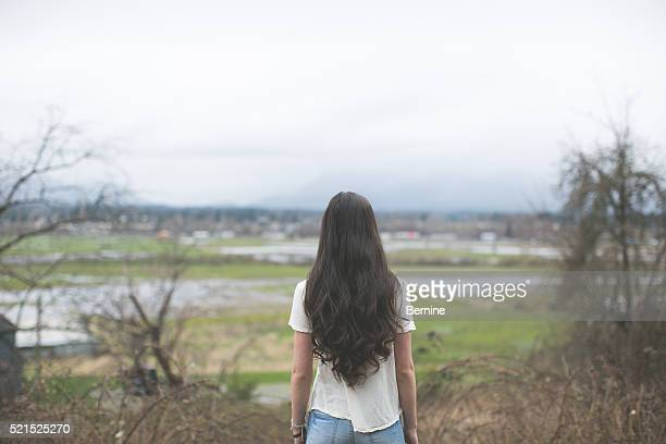 Young Adult Female Looking Out Over Horizon