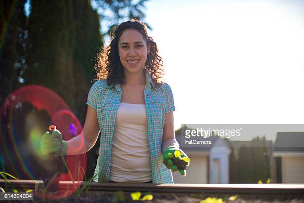 young adult female ready to plant in her garden - get your hoe ready stock pictures, royalty-free photos & images