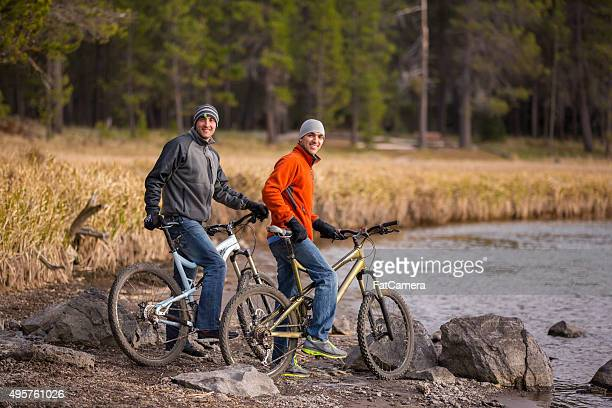 young adult friends biking together outdoors - bend oregon stock photos and pictures