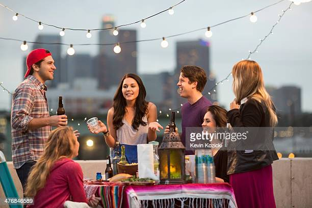 Young adult friends having fun at barbeque