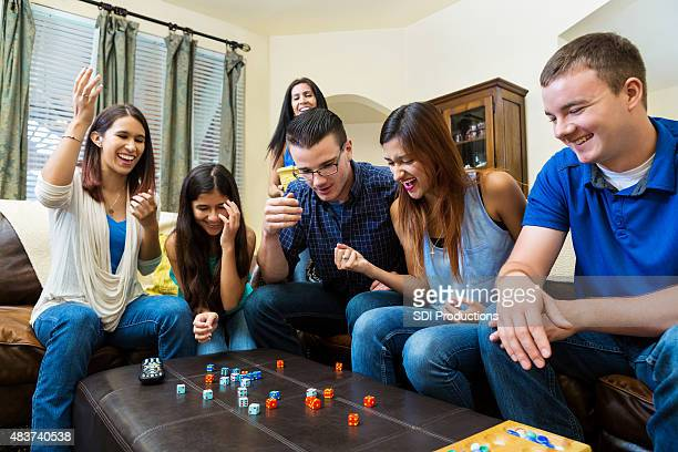 Young adult friends having fun, playing games at home