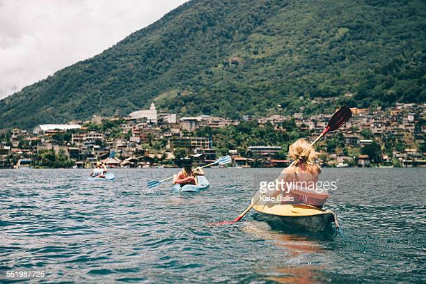 Young adult friends kayaking on Lake Atitlan, Guatemala