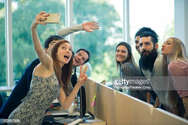 young adult friends taking group selfie - multimedia stock pictures, royalty-free photos & images