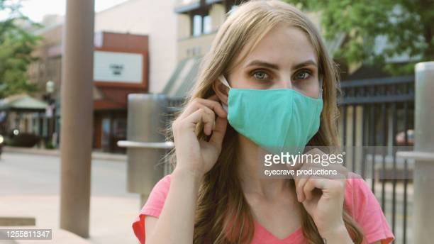 young adult generation y caucasian female with mask in western america small town - eyecrave  stock pictures, royalty-free photos & images