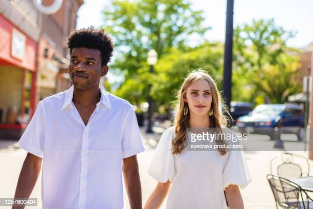 young adult generation y friends multi-ethnic couple in western america small town photo series - eyecrave  stock pictures, royalty-free photos & images