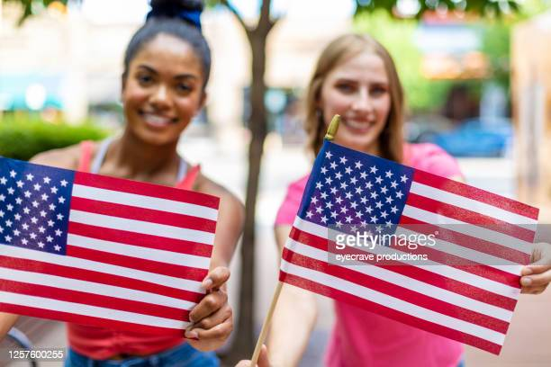 young adult generation y patriotic african american and caucasian female friends multi-ethnic group in western america small town photo series - eyecrave  stock pictures, royalty-free photos & images