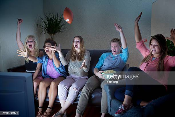 Young Adult Group Watching Football Sport TV Together at Home