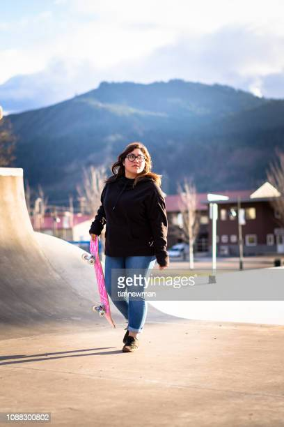 Young Adult Hispanic Woman Skateboarding