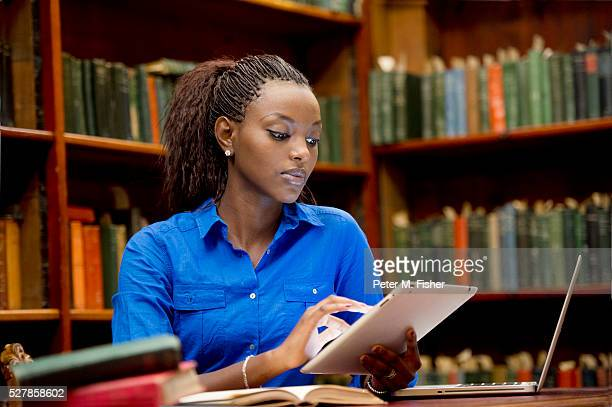 young adult in library - free images for educational use stock pictures, royalty-free photos & images