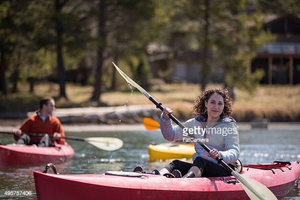 Young adult kayaking on river
