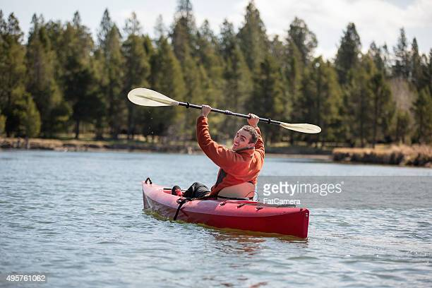 young adult kayaking on river - bend oregon stock photos and pictures