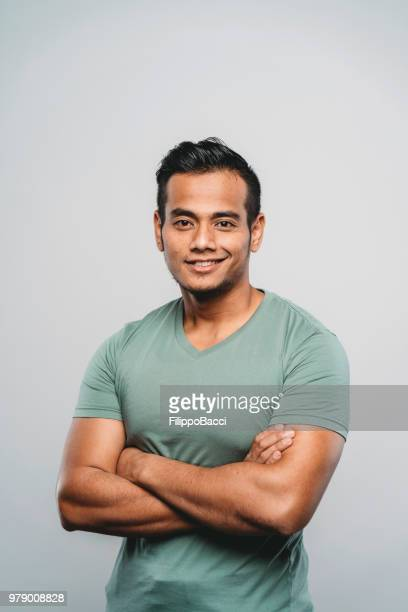 young adult malaysian man portrait in studio - malaysian culture stock pictures, royalty-free photos & images