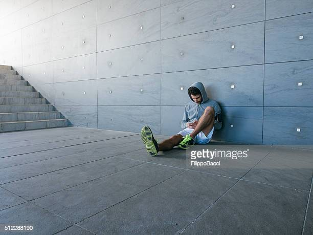 Young Adult Man Browsing The Net With Smartphone