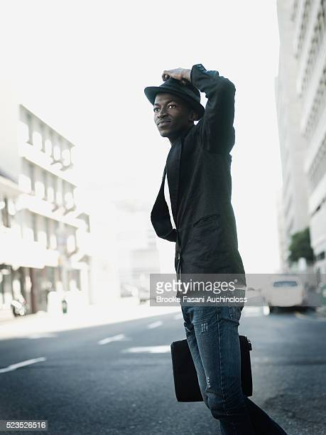 young adult man crossing a street - one young man only stock pictures, royalty-free photos & images