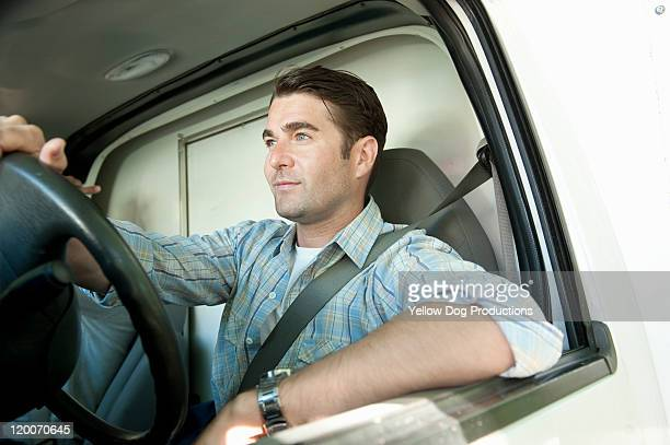 Young Adult Man driving truck