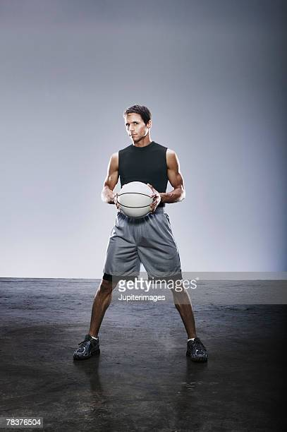 Young adult man holding basketball