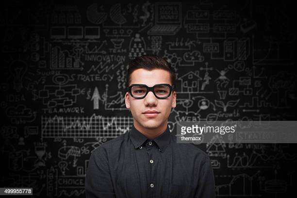Young adult man on blackboard
