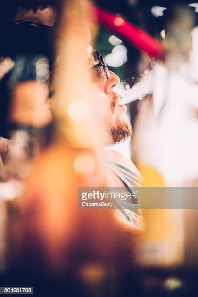 young adult man smoking hookah - water pipe - hookah stock pictures, royalty-free photos & images