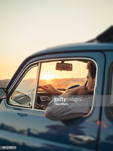 young adult man trip with vintage car - vintage car stock pictures, royalty-free photos & images
