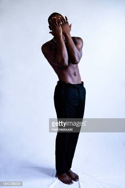 """young adult man with dark skin studio portrait. - """"martine doucet"""" or martinedoucet stock pictures, royalty-free photos & images"""