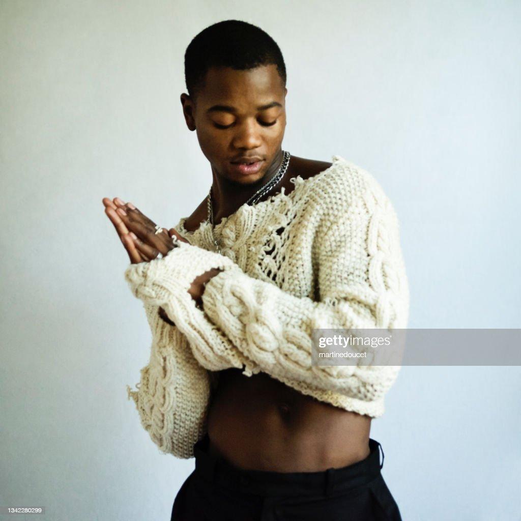 Young adult man with dark skin studio portrait. : Stock Photo