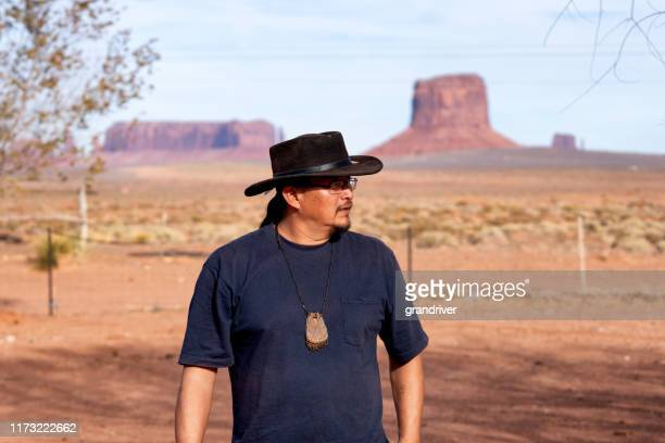 young adult native american navajo man outside in monument valley arizona - apache stock pictures, royalty-free photos & images