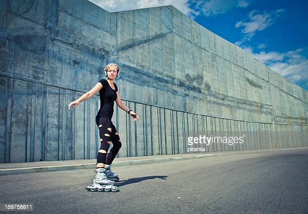 young adult on roller skates - inline skate stock photos and pictures