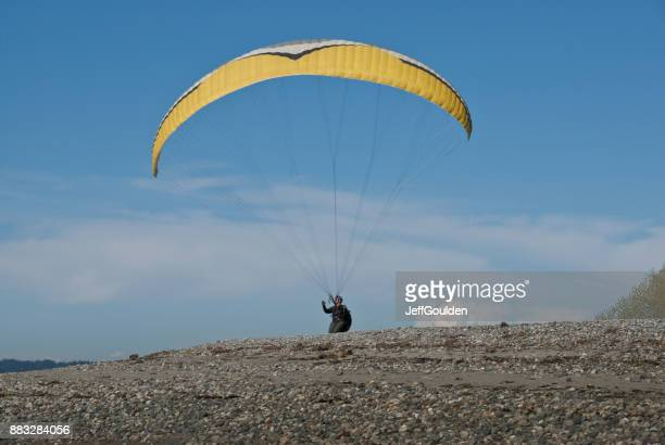 Paraglider Taking Off From a Hill