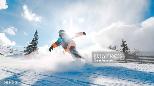 young adult snowboarding in trysil, norway. - ski resort stock pictures, royalty-free photos & images