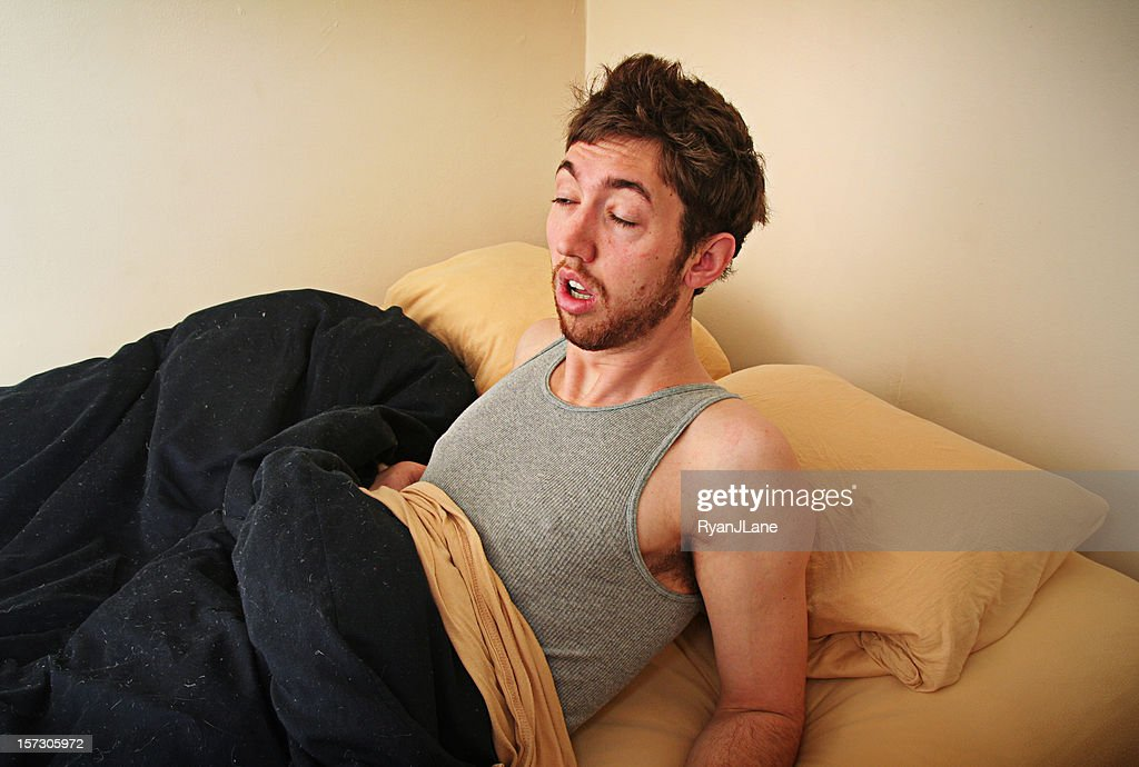 Young Adult Struggles to Wake Up In the Morning : Stockfoto