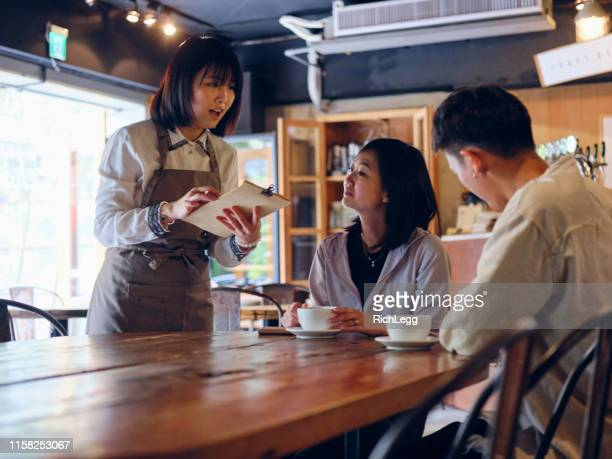 young adult taiwanese waiter in a coffee shop - part time job stock pictures, royalty-free photos & images