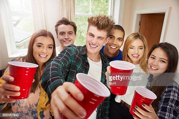 young adult toasting camera