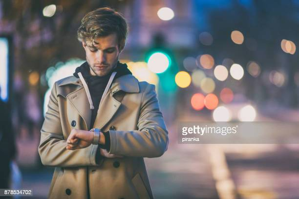 young adult waiting - instrument of time stock photos and pictures
