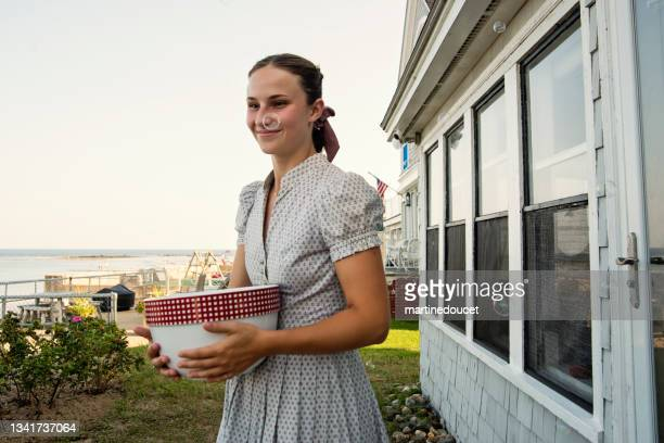 """young adult woman at wedding celebrations in family beach house. - """"martine doucet"""" or martinedoucet stock pictures, royalty-free photos & images"""